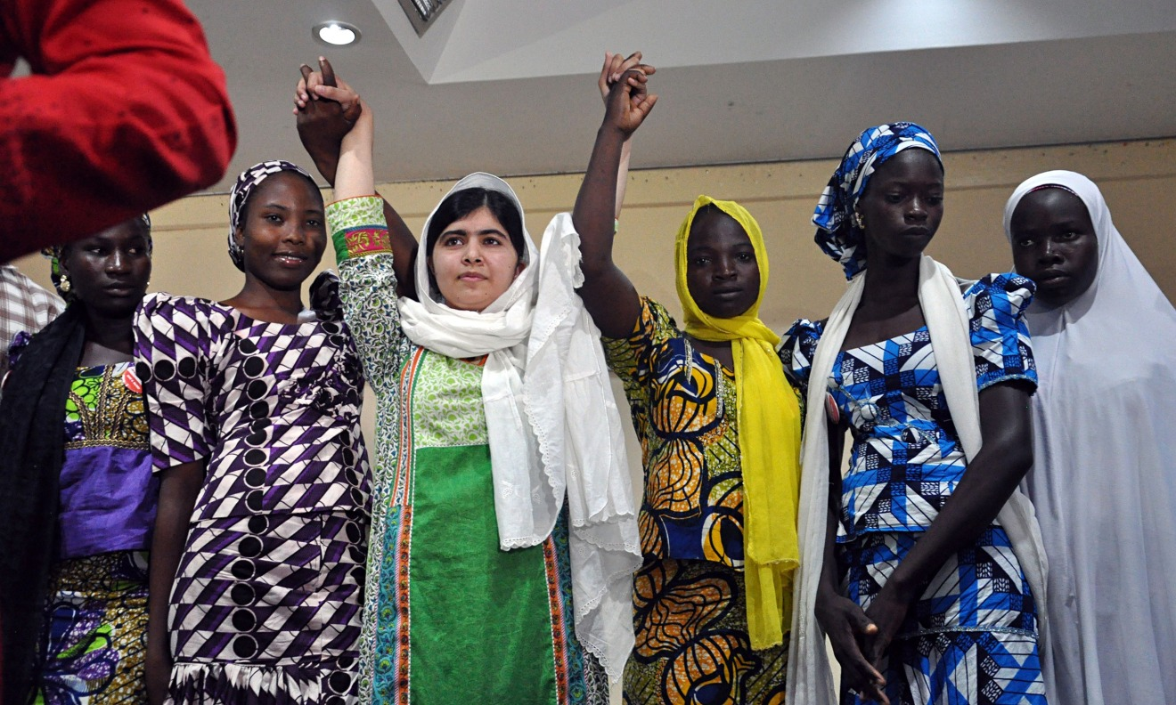 Young Pakistani activist Malala Yousafzai with five of the abducted Chibok schoolgirls who escaped