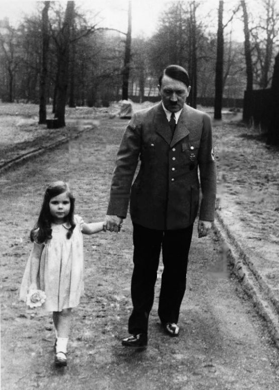 Hitler taking a walk with Helga Goebbels