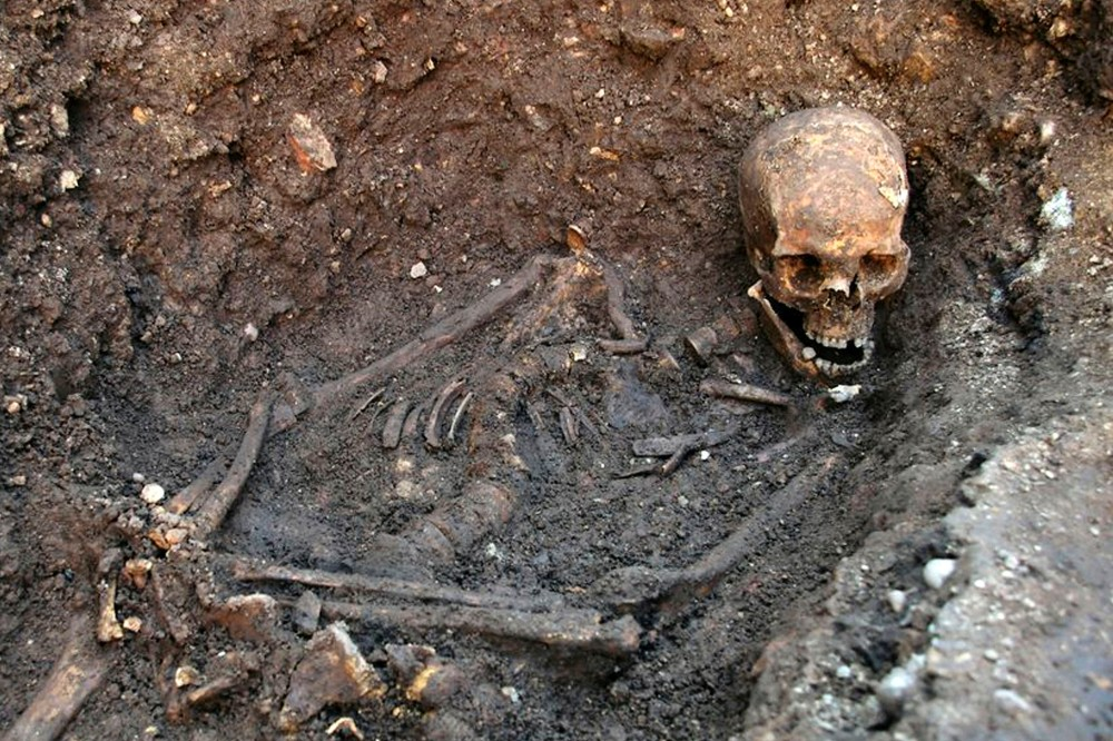 FILE- This is an undated file photo released by the University of Leicester, England, showing the remains human skeleton found underneath a car park in Leicester, England, September 2012, which has been declared