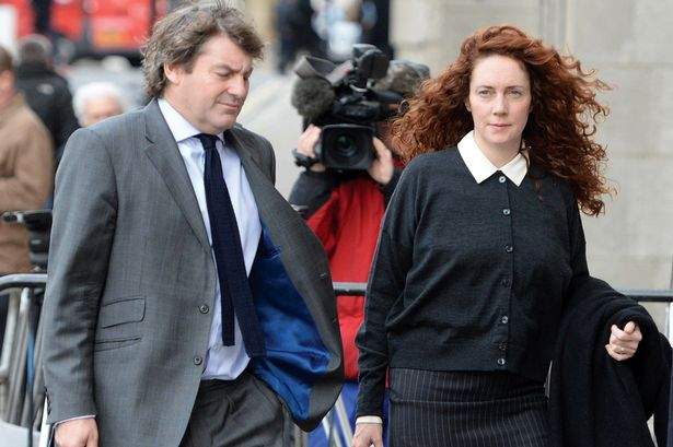 Rebekah & Charlie Brooks walking to trial