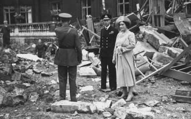 Queen Elizabeth and King George survey the damages after the Royal Chapel at Buckingham Palace is reduced to rubble after being destroyed by a Nazi bomb attack in September of 1940.