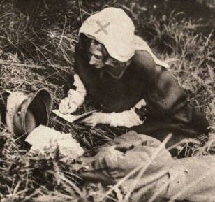 A nurse from the Red Cross takes dictation of the last thoughts of a dying British soldier while on the battlefield.