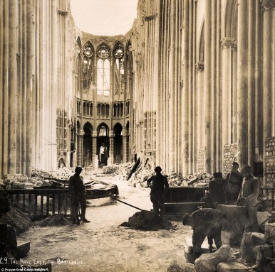 French soldiers examine the bomb damaged, ceiling-less North Nave of the great medieval Gothic Cathedral in Reims, France. (wikipedia.org)