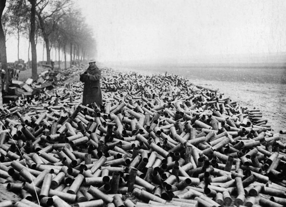 An Austrian soldier stands atop a mountain of a mere week's worth of used bomb shellings. (historyboomers.blogspot.com)