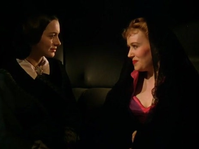 Olivia de Havilland as Melanie Wilkes with Belle Watling