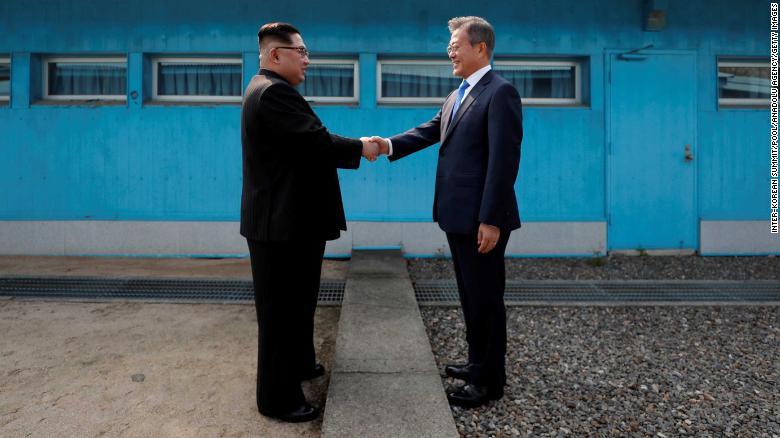 Koreas shake hands